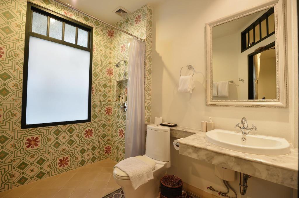 バンコクの小さなお屋敷ホテルのかわいらしい客室